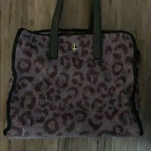 Like new Kate spade bag. Fur like leopard print.